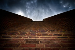 Brick wall to dark sky Royalty Free Stock Images