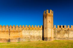 Brick wall with tower. Medieval Italian walled town.  Royalty Free Stock Images
