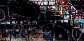 Brick wall with traces of paint and elements of graffiti. Web ba Stock Images