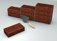Brick wall and trowel, mason tools Royalty Free Stock Photos