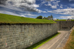 Brick Wall with Tunnel. A long brick wall with a tunnel for military use Royalty Free Stock Image