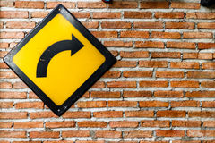Brick wall with turn right sign Royalty Free Stock Photography
