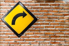 Brick wall with turn right sign Stock Photo