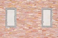 Brick wall with two frame Royalty Free Stock Photos