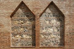 Brick wall with two niches. Old brick wall with two niches royalty free stock images