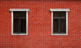 Brick wall with two windows Royalty Free Stock Photography