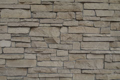 Brick wall of uneven stone of different sizes for texture and background Royalty Free Stock Images