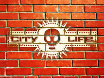 Brick wall with urban life sign Royalty Free Stock Image