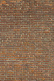 Brick Wall. Usual brick wall of an old house, the vertical Royalty Free Stock Photo