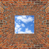 Brick wall and view to the sky overhead Royalty Free Stock Image