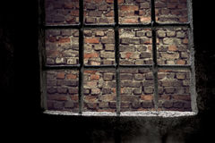 Brick wall viewed through prison window Stock Photography