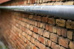 Brick Wall and Water pipe. Photo Royalty Free Stock Photo