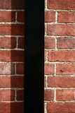 The brick wall with water-shoot Stock Photo