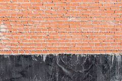 Brick wall with a waterproofing Stock Image