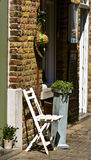 Brick wall and white chair on doorsteps Stock Photography