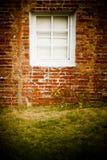 Brick Wall with white window Royalty Free Stock Photos