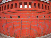 Brick wall with wide angle fisheye view. Red brick wall with wide angle fisheye view royalty free stock photos