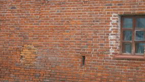 Brick wall with a window. Old red brick wall with window stock video