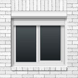Brick wall with window and rolling shutters Royalty Free Stock Photography