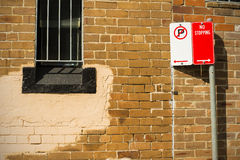 Brick wall window security grill sign posts Royalty Free Stock Photo