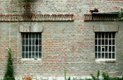 Brick wall with windows Stock Photos