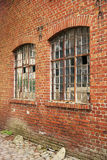 Brick wall and Windows. Industrial old building brick wall with two windows Stock Photo