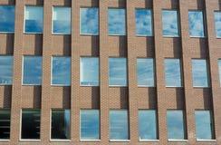 Brick wall and windows office building facade. Office building facade bricks and windows perspective Royalty Free Stock Photos