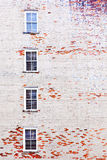 Brick wall with windows Stock Images
