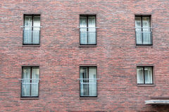 Brick wall with windows Stock Photography