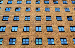 Brick wall with windows Stock Image