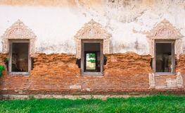 Brick wall and windows. Texture of ancient brick wall and window royalty free stock images