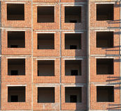 Brick wall with windows under construction Stock Images