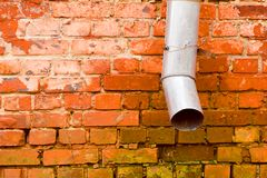 Brick Wall With Spout Royalty Free Stock Images