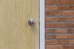 Brick Wall and Wood Door Knobs. royalty free stock photography