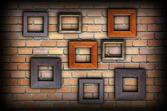 Brick wall with wood frames Royalty Free Stock Images