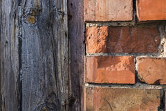 Brick wall and wood planks texture. Vintage background half wood and half bricks Stock Image