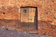 Brick wall with wooden door. Royalty Free Stock Images