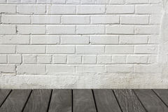 Brick wall with wooden floor Royalty Free Stock Image