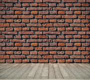 Brick  wall and wooden floor Royalty Free Stock Image