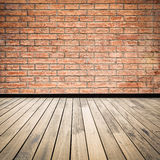 Brick wall and wooden floor Royalty Free Stock Photo