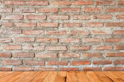 Brick wall and wooden floor Stock Images