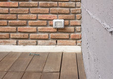 BRICK WALL WITH WOODEN FLOOR Stock Image