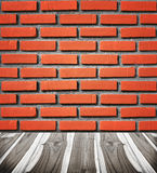 Brick wall with wooden floor. In room style Royalty Free Stock Photo