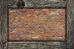 Brick wall and wooden frame Stock Photos