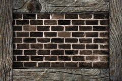 Brick wall and wooden frame Royalty Free Stock Photo