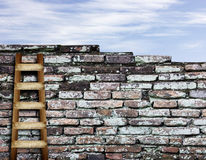 Brick wall with wooden ladder background Stock Photo