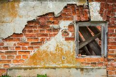 Brick wall with wooden window. Brick wall with peeling plaster and wooden window Stock Photos