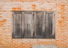 Brick wall with wooden window texture background. Vintage Brick wall with wooden window texture background Royalty Free Stock Photo