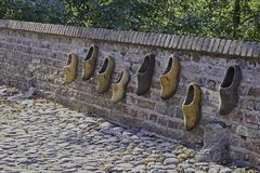 Brick wall with worn wooden shoes in fortified Elburg Stock Photo