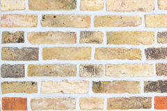 Brick wall with yellow and red stones Royalty Free Stock Photography